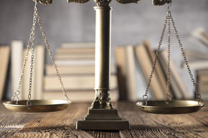Legal scales with books. Judge, justice concept background. Scale of justice on wooden rustic table.